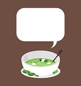 Organic peas soup in the white bowl.