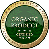 Organic product certified vegan gold product label with a green laurel wreath.