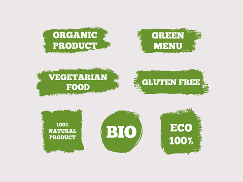 Organic Product, Green Menu, Vegetarian Food, Gluten Free, 100% Natural, Bio, Eco. Set of green logos. Seven isolated stickers. Sketch, grunge, graffiti.