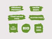 Organic Product, Green Menu, Vegetarian Food, Gluten Free, 100% Natural, Bio, Eco. Set of green logos. Seven isolated stickers. Sketch, grunge, graffiti. Vector illustration.