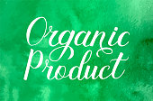 Organic Product hand written on green watercolor background. Calligraphy lettering sign. Healthy food concept. Vector logo design  for fresh market, restaurant, farm, store, etc.