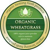 Organic farming wheatgrass juice powder rich in nutrients on a gold label.