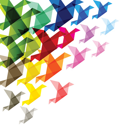 Origami birds colorful in the corner on a white background.