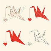 Set of origami cranes with origami heart