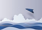 Origami made dolphin in the sea
