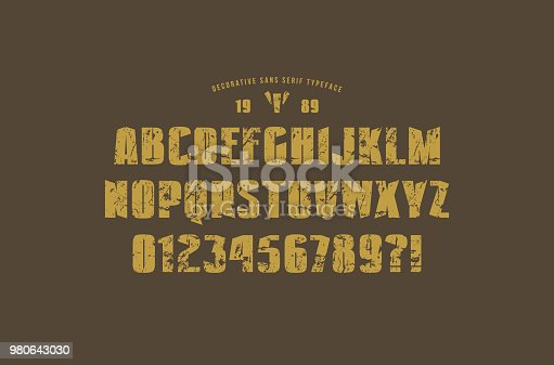 Original solid sans serif font. Extra bold face. Letters and numbers with rough texture for label and emblem design. Print on brown background