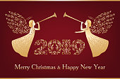 Ornamental Christmas numerals 2019 and two angels with ornamental wings. Beautiful angels with trumpet in golden ornate dress. Happy New Year and Merry Christmas golden text on dark red background.