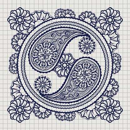 Ornate yin-yang sign on notebook background