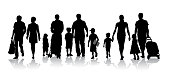 Large group of people walking and holding hands with their kids