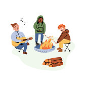 istock Outdoor pastime with friends, camping vacation, enjoying nature set. Three friends around a bonfire playing guitar and singing, frying the marshmallow, having fun. Vector moveable characters. 1326612511