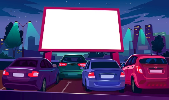 Outdoors car cinema with empty white screen