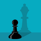 A chess pawn is standing by the wall and a pawn thinks she is a queen
