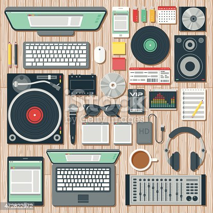 An overhead view of items you might find on the desk of a DJ (disk jockey), including: Laptop, tablet, smart phone, computer, turntable, headphones, splitter, speaker, CDs, records, microphone, hard drive, equalizer software, VIP pass, concert ticket, USB Flash drives, mixer, and so on. No gradients or transparencies used. File is organized into layers and each icon is properly grouped for easy editing.