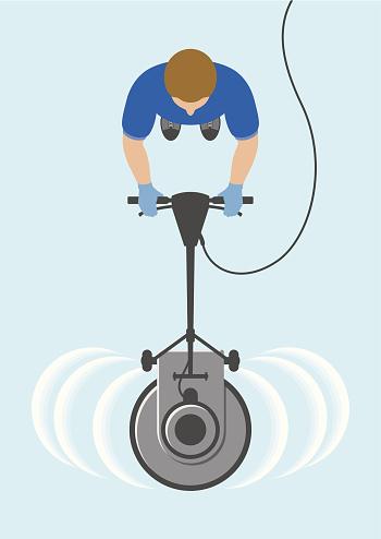 Overhead view of man cleaning floor