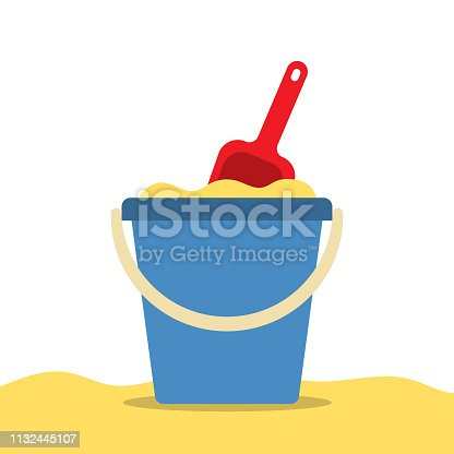istock Pail with sand and shovel for a sandbox. Beach toys. 1132445107