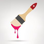 Paint brush with wooden handle and dripping paint