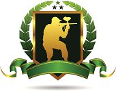 Green Paintball Emblem with Golden Elements