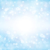 Soft pastel blue colour shining star square background stock photo. Looks like twinkling lights light shiny background. Vignette, vignetting, copy space. No people. No text. Apt for party, Xmas, Christmas, New Year's eve, birthday party celebration backdrop, wallpaper,  romantic gift wrapping paper. A bright white light brightens up the centre, middle or center of the frame.