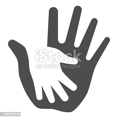 istock Palm of child in adult solid icon, kids protection concept, helping hand sign on white background, child protection by parents or volunteers icon in glyph style. Vector graphics. 1285387549