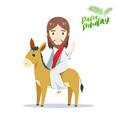 palm sunday - Jesus is riding a donkey behind palm leaves
