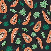 Papaya fruits and leaves seamless pattern with black background. Tropical fuits