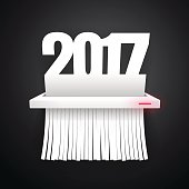 Document 2017 is cut into shredder on dark background. Clipping paths included.