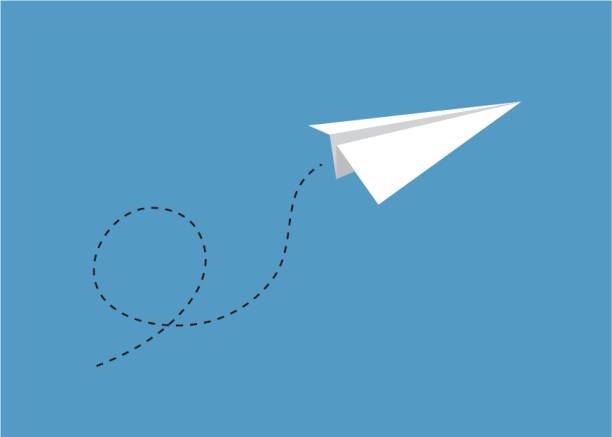 Paper Airplane Flying Through Blue Sky A single paper airplane flying through a blue sky with a dotted line path with a loop. paper airplane stock illustrations