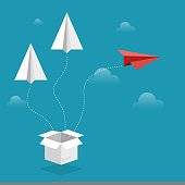 Paper airplanes coming out of a white box flying on blue sky with clouds isolated on blue background. Business teamwork and one different creative vision idea concept. Eps 10 vector flat Illustration