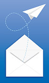 Vector illustration of a paper airplane flying out of a white envelope on a blue background.