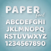 Paper alphabet. White letters and numbers on blue background