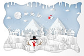 Paper art and cut  craft style design of Santa Claus on Sleigh and Reindeer in the snow village and snowman in the winter background as holiday and merry christmas or x'mas day concept. vector illustration.