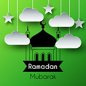Paper Art Greeting Background for Holy Month Ramadan Kareem. Green vector illustration with mosque, hanging paper clouds and stars