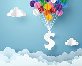 Paper art of dollar sign hanging with colorful balloon