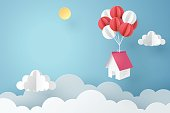 Paper art of house hanging with colorful balloon, business concept and asset management idea