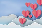 paper art of red balloon heart on blue sky background,vector