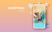 Paper art of smartphone for online shopping your text space background, Shopping Cart Floating on mobile phone concept,Balloon by dollar money on pastel color,Shopping via the internet shop. vector.