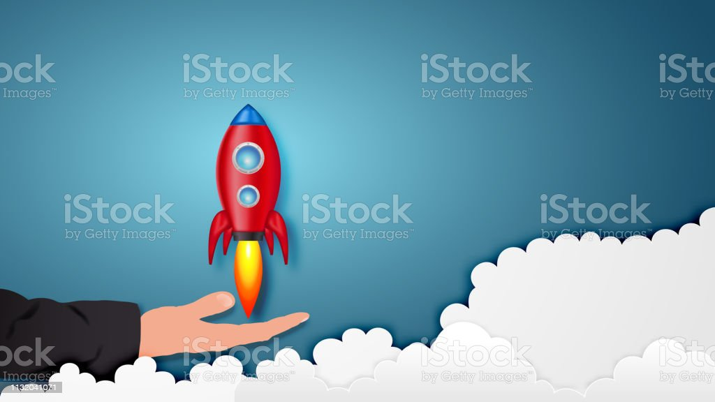 Paper art style of Rocket launch on hand as business start up and...