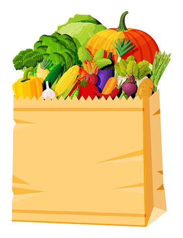 Paper bag full of fresh vegetables.