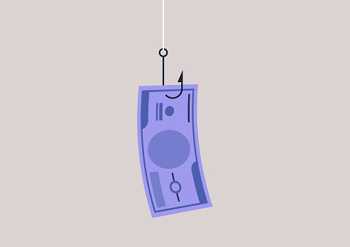 A paper banknote hanging on a hook, online scam, phishing activity