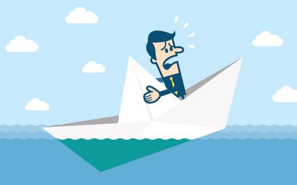 papierschiff sinkt im wasser - gesunken stock-grafiken, -clipart, -cartoons und -symbole