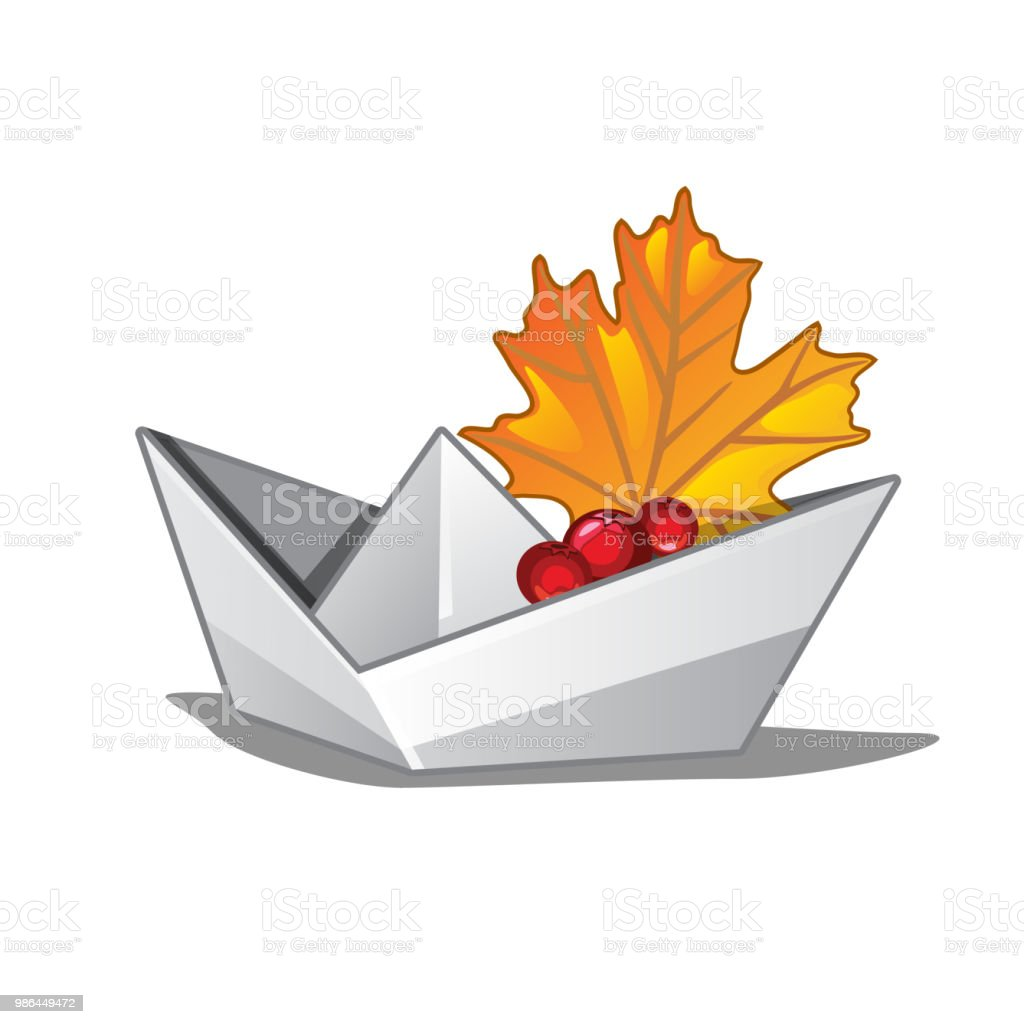 Paper boat with a fallen maple leaf. Symbols of autumn isolated on...