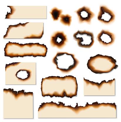 Paper burnt holes and scraps edges scorched