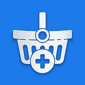 istock Paper cut Add to Shopping basket icon isolated on blue background. Online buying concept. Delivery service. Supermarket basket symbol. Paper art style. Vector Illustration 1253645693