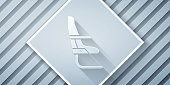 Paper cut Airplane seat icon isolated on grey background. Paper art style. Vector Illustration