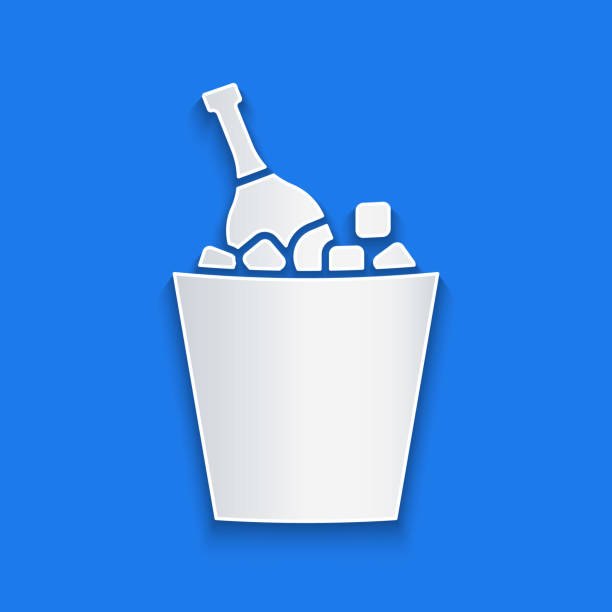 Paper cut Bottle of champagne in an ice bucket icon isolated on blue background. Paper art style. Vector Illustration Paper cut Bottle of champagne in an ice bucket icon isolated on blue background. Paper art style. Vector Illustration alcohol drink clipart stock illustrations