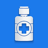 Paper cut Bottle of medicine syrup icon isolated on blue background. Paper art style. Vector Illustration