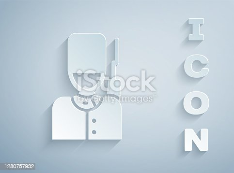 Paper cut British guardsman with bearskin hat marching icon isolated on grey background. Paper art style. Vector.
