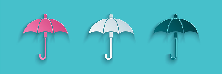 Paper cut Classic elegant opened umbrella icon isolated on blue background. Rain protection symbol. Paper art style. Vector Illustration