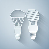 Paper cut Economical LED illuminated lightbulb and fluorescent light bulb icon isolated on grey background. Save energy lamp. Paper art style. Vector Illustration