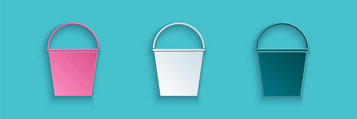 Paper cut Fire bucket icon isolated on blue background. Metal bucket empty or with water for fire fighting. Paper art style. Vector Illustration